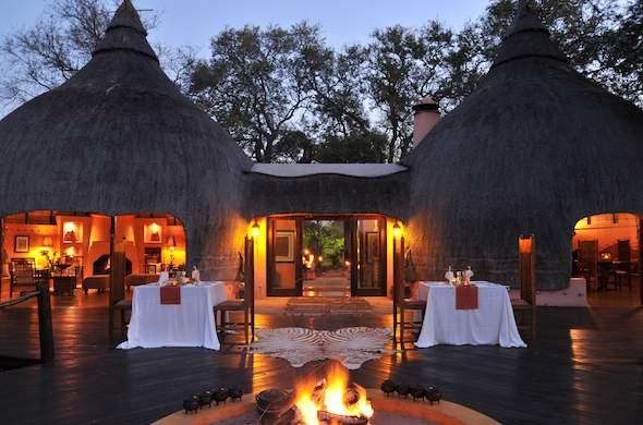 Exterior of the main deck at Hoyo Hoyo Safari Lodge at night.