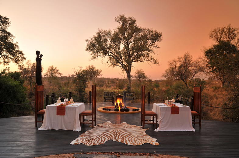 Dine while the African sun sets over the bushveld.