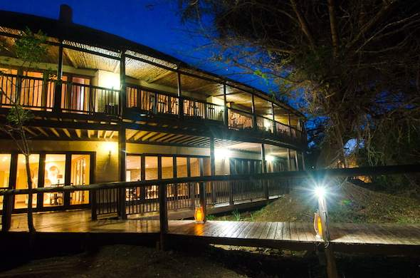 Exterior of Shishangeni Lodge at night.